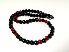 Men's Black and Red Beaded Necklace Featuring Black Agate and Red Sea Coral. $28.00, via Etsy by Designed by Audrey
