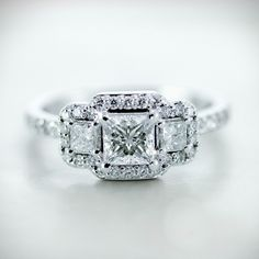 Twinkling Trio Ring || Princess Cut Diamond Halo Ring With White Diamonds In 14k White Gold