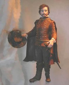 1/12 scale dollhouse miniature doll. Tudor Man by Penny Thomson. Found on the excellent doll board https://www.pinterest.com/jennywrendolls/miniature-dolls/.