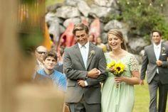 bridesmaids and groomsmen walking down the aisle
