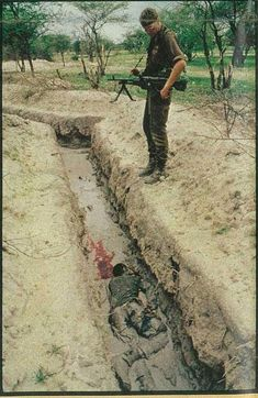 A South African soldier looks at the aftermath of a base assault Angola Military Guns, Military History, Casualties Of War, Vietnam War Photos, My War, Defence Force, War Machine, Armed Forces, South Africa