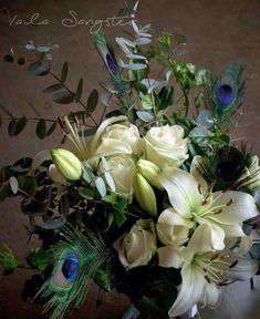Who would have thought that adding peacock feathers to a bouquet would make such a huge difference? The feathers complimented the white lilies and crisp greens. Something to keep in mind when using feathers in an arrangement is that less is more, not many are needed to create the 'wow' factor. White Lilies, Wow Factor, Peacock Feathers, Less Is More, Keep In Mind, Wow Products, Compliments, Crisp, Bouquet
