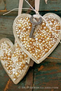 Paint wooden heart, glue pearls, apply Valspar Signature Colors 1/2 Pint Antiquing Asphaltum Glaze (from Lowe's) and add embellishments.