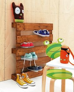 A simple wooden pallet has slits that perfectly fit shoes. | 33 Ingenious Ways To Store Your Shoes