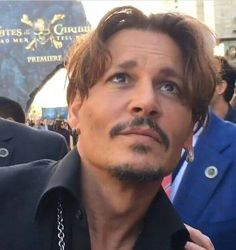 I swear to god, how does johnny depp look this good from this angle?