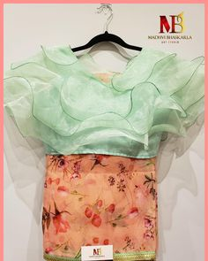 Restocked on demand ! Trendy Ruffles blouse with organza saree SOLD . Saree Blouse Neck Designs, Fancy Blouse Designs, Dress Designs, Kids Party Wear Dresses, Stylish Blouse Design, Organza Saree, Designer Blouse Patterns, Blouse Models, Ruffle Blouse