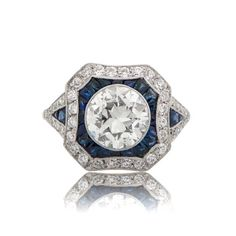 Discover a one-of-a-kind beautiful Estate Diamond and Sapphire Engagement Ring, set in platinum, and accented with stunning diamonds and sapphires.