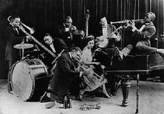 "King Oliver's Creole Jazz Band, ""Workingman's Blues"" (Joe Oliver) 1923 ·King Oliver and his Creole Jazz Band — featuring Louis Armstrong on second cornet, Lil Hardin on piano, and Johnny Dodds on clarinet (mp3 available at source)"