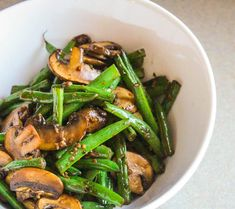 A recipe for sautéed mushrooms and green bean that are coated in a garlic-soy sauce. This can be on the table in under 10 minutes!