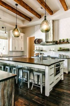 My idea for cabinets under the seating area!  This kitchen is about 4 times as big as ours, but the idea stands.  --AM
