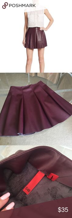 "HPNWT Flouncy Plum Colored Vegan Leather Skirt Step into fall with this adorable plum colored faux leather skirt! New with tags! Flared a-line skirt, side hidden zip, 15"" long, flouncy so there's so cute movement. Polyurethane/polyester material. Super soft and comfortable on. Hand wash only. Perfect look with a cashmere sweater and boots or blouse and heels. ❤️ 5/48 Skirts Mini"