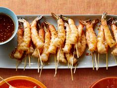 Recipe of the Day: Bobby's Grilled Shrimp Skewers Pierced with wooden skewers, these Asian-style shrimp get their flavor from a marinade of soy, ginger, sesame oil, white wine vinegar and peanut oil. Sprinkle these quick-to-cook shrimp with toasted sesame seeds after just a few minutes on the grill.