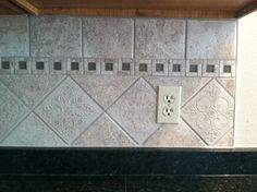 Google Image Result for http://hardwoodfloorandmore.com/PhotoGallery/Tile/backSplash/Kitchen_Backsplash_close400x300.gif