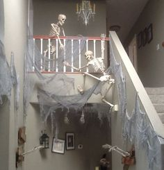 Skeletons climbing the stairs is rather bone chilling. See more party and Halloween decoration ideas at one-stop-party-ideas.com