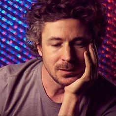 Aidan Gillen looking pensive