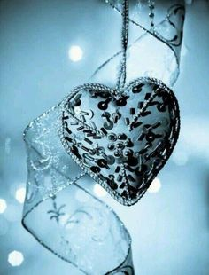 A BLUE HEART WITH BLACK TRIM..