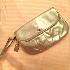 Coach Large Flap Wristlet *NEW* Coach large flap Wristlet. Color is called Pewter, looks like a shimmery gold. Many pockets inside and external zippered pocket. Coach Bags Clutches & Wristlets