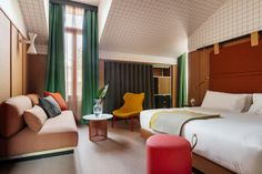 Experience a taste of Milanese culture at the boutique Room Mate Giulia Hotel in Milan with modern rooms and design by Patricia Urquiola.