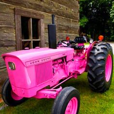 Whispering Pines Antiques & Decor. I NEED this ;-) I know someone who would die for this pink John Deere Tractor!