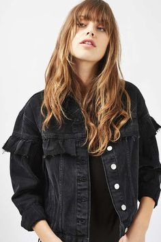 Denim jackets are having a moment, and we love the frill detail on this washed black version. Perfect over a sheer midi dress for AW's high/low layering look. #Topshop