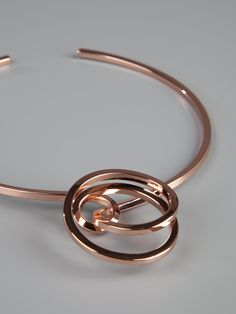 Gold tone metal choker style necklace from Maison Martin Margiela featuring a spiral pattern front detail