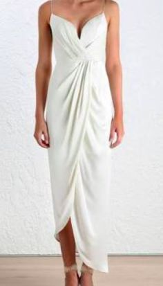 Ethereal and alluring, the Sueded Silk Plunge long Dress paints the picture of luscious silk dancing down the body. The fluid-like draping is contrasted with a structured bustier. Dry clean only. Wedding Dresses Under 500, Alternative Wedding Dresses, Perfect Wedding Dress, Wedding Dress Styles, Alternative Bride, Cocktail Wedding Dress, Cocktail Dresses, Wedding Gowns, Bridal And Formal