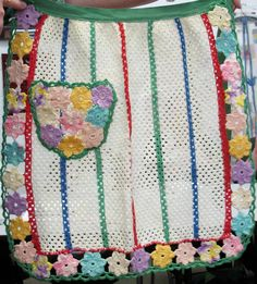 What about a yoyo pocket backed with fabric? This is a Crochet Embellished Vintage Dishcloth Apron
