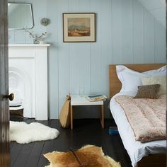 painted floor + wood paneling + fireplace + hides