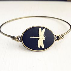 Dragonfly Bangle Bracelet / Dragon Fly Lover Gift Steampunk Costume Cosplay Wedding Bridesmaids Boho Bohemian Insect Bug Silhouette Gothic by lydiasvintage on Etsy https://www.etsy.com/listing/506485103/dragonfly-bangle-bracelet-dragon-fly
