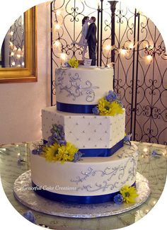 Elegant Ivory Wedding Cake with Blue and Silver Accents | Flickr