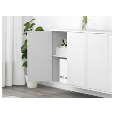 EKET Wall-mounted cabinet combination - white, white stained oak effect - IKEA Ikea Bar Cabinet, Storage Cabinets, Tall Cabinet Storage, Locker Storage, Loft Storage, Ikea Eket, Ikea Wall, Flexible Furniture, Personal Storage