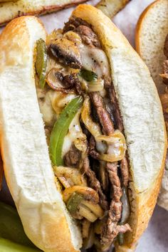 The classic famous Philly Cheesesteak sandwich is so easy to make at home! The thinly sliced steak is sauteed with mushrooms, green pepper and onion then topped with provolone cheese. The sandwich is classically served in a hoagie roll with French Fries or chips and pickles. #valentinascorner #philly #sandwich #phillysandwich #sandwichrecipe #phillycheesesteak #cheesesteak #dinner