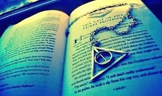 harry potter and the deathly hallows. i want this necklace.and i want the deathly hallows. I AM A MASTER OF DEATH! Harry Potter Tumblr, Harry James Potter, Deathly Hallows Necklace, Deathly Hallows Symbol, Hogwarts, Mischief Managed, Book Worms, The Help, Arrow Necklace