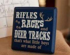 Rifles, racks, deer tracks- boy's room decor