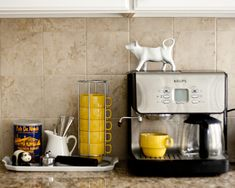 I love coffee stations in the kitchen. And I won't rest until I've tracked down those yellow mugs, which I'm sure have long since been discontinued.  (eta: They were from World Market, but alas, they are not on the website.)