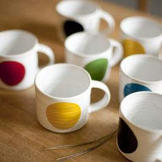 Camilla Engdahl Mugs. If we ever run out/break all our mugs, I know what I'm getting...