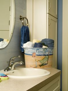Hey this is an ordinary sink but juust a simple painted theme bucket with towels gives it a different Spirit!sba  Coastal Design, Pictures, Remodel, Decor and Ideas