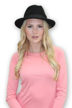 Enhance your style with this chic wool felt fedora. The crown is wrapped with a matching grosgrain ribbon band that is femininely tied in a flat bow. UPF 50.