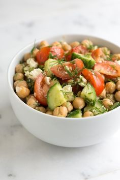 Easy chickpea salad recipe with lemon fresh dill crisp cucumber and tomatoesthats quick to make and you can make it in advance. Easy chickpea salad recipe with lemon fresh dill crisp cucumber and tomatoesthats quick to make and you can make it in advance. Chickpea Salad Recipes, Best Salad Recipes, Lemon Recipes, Vegetarian Recipes, Cooking Recipes, Healthy Recipes, Healthy Meals, Easy Recipes, Delicious Salad Recipes