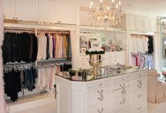Beautiful white and silver walk-in closet with chandelier and island #closet - More girly closet, another option.