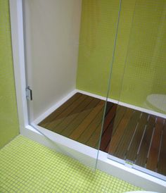CORIAN SHOWER WITH WOOD FLOOR AND TILE