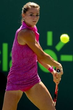 Camila Giorgi Photos - Camila Giorgi of Italy returns a shot to Simona Halep of Romania during day 7 of the Miami Open Presented by Itau at Crandon Park Tennis Center on March 2015 in Key Biscayne, Florida. - Camila Giorgi Photos - 262 of 470 Camila Giorgi, Tennis Clubs, Sport Tennis, Wta Tennis, Simona Halep, Tennis Players Female, Beautiful Athletes, Tennis Stars, Tennis Clothes