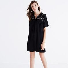 """An easy silk babydoll upgraded with all kinds of artful details—delicate shirring, a fringed neckline and intricate embroidery dotted with tarnished metal sequins. A truly cool party dress—no constricting underpinnings required. <ul><li>Nonwaisted.</li><li>Falls 35 3/8"""" from highest point of bodice.</li><li>Silk.</li><li>Partially lined.</li><li>Dry clean.</li><li>Import.</li><li>Select stores.</li></ul>"""