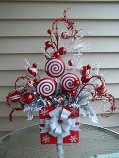 """50 Best Candy Cane Christmas Decorations which are the """"Sweetest things you've Ever Seen"""" - Hike n Dip Christmas Flower Arrangements, Christmas Flowers, Christmas Fun, Christmas Wreaths, Christmas Ornaments, Christmas Parties, Office Christmas Decorations, Christmas Table Centerpieces, Christmas Tabletop"""