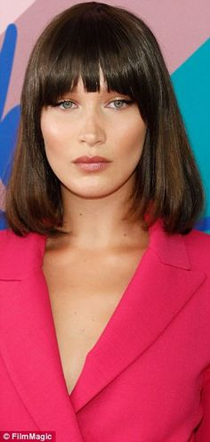 She's bangin'! Hairstylist Jen Atkin added faux fringe to Bella Hadid's blunt bob, which a...