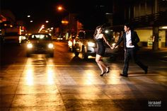 Couple running for love. Engagement session, night, city, street, wedding photographer, sesion de fotos casual, preboda, Chihuahua, couple, photo session