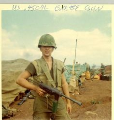 Marine with a grease gun, 1967