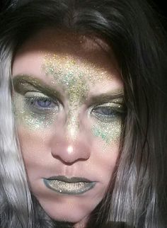Halloween Look:  Radiation Vibe foiled on eye, Diamond Dogs on face and lips. Glitter shadows: Bollywood, Dirty Martini, & Champagne Supernova.   Wet n Wild Fantasy Maker Stencil was used.
