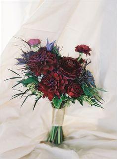 hybrid black baccarra roses, burgundy dahlias, wine colored anenomes, black sunflowers, purple ranunculus, hellebores, clematis, burgundy scabiosa buds, chocolate Geranium, succulent, Eucalyptus