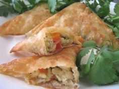 Southwest Chicken wontons - wrappers, canned chicken, green/red pepper, onion, garlic, salsa, ranch - can be baked or fried